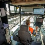Several screens help the crane operator to monitor the gantry crane's movements. However, his work is primarily done visually. To load and unload the semi-trailers, the crane operator is assisted by personnel on the ground.