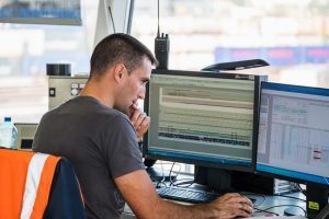 As a scheduler, Eric works in the central control room.