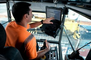 Inside his cabin, at 12 metres from the ground, the crane operator works with high precision.