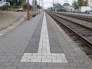 Over time, the yellow safety lines are replaced by white podotactile lines (with relief).